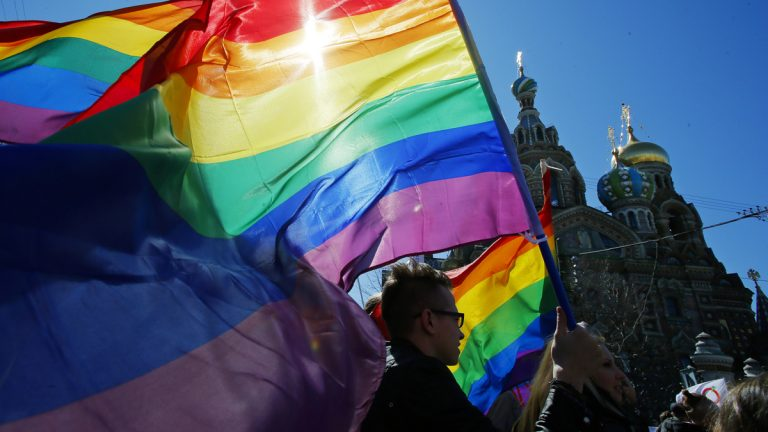 Gay rights activists carry rainbow flags as they march during a May Day rally in St. Petersburg, Russia. (AP Photo/Dmitry Lovetsky, file).