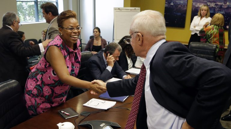 Camden Mayor Dana Redd, left, greets Alfred C. Koeppe, chairman of The New Jersey Economic Development Authority, Thursday in Trenton, N.J., after the EDA voted on a $260 million tax break over 10 years for a manufacturing firm that wants to do business in Camden. (AP photo/Mel Evans)