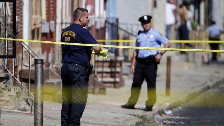 Philadelphia police at a crime scene.  (AP Photo/Matt Rourke)