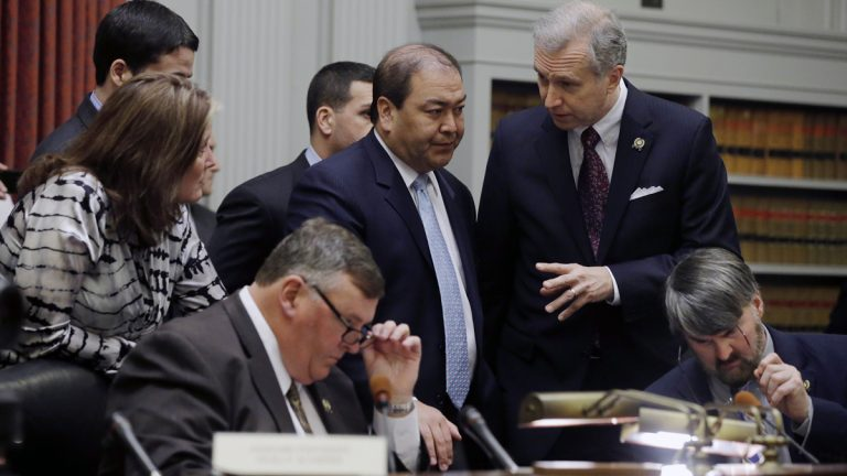 New Jersey Sen. Kevin O'Toole, center, listens to Sen. John Wisniewski, standing right, as the legislative committee prepares to hear testimony on Bridgegate. (AP file photo/Mel Evans)