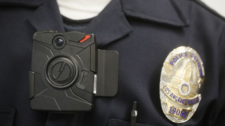 A Los Angeles police officer wears an on-body camera during a demonstration. New Jersey is looking into a statewide launch of the cameras. (AP file photo)