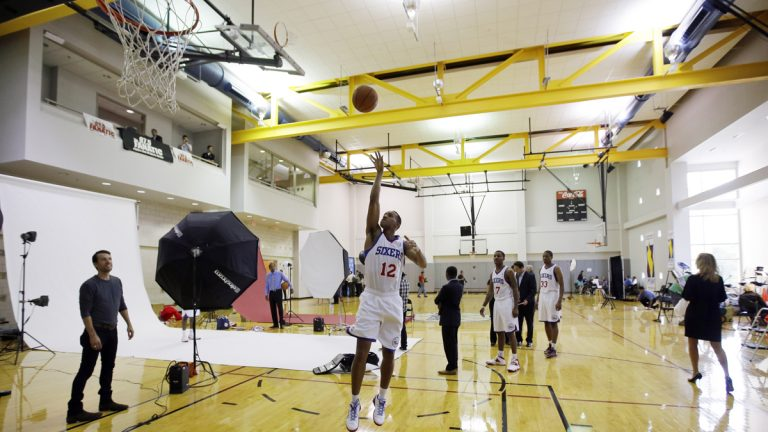 Philadelphia 76ers' Evan Turner goes up for a shot as he waits on photographers during NBA basketball media day at the team's practice facility in 2013, in Philadelphia. By next summer, the Sixers hope to open an $82 million, 120,000-square-foot facility across the Delaware River in Camden. (AP photo/file)