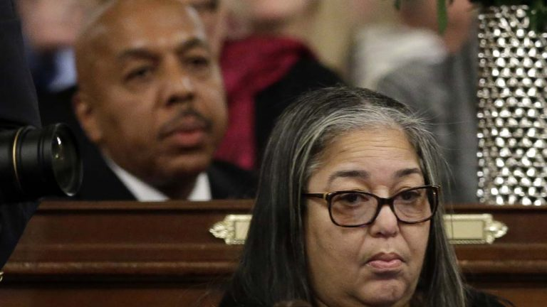 State Rep. Ron Waters, D-Philadelphia, left, and state Rep. Michelle Brownlee, D-Philadelphia, are seen at their desks in January at the state Capitol in Harrisburg. Both have since pleaded guilty in a corruption sting and resigned their seats. They will keep their pensions.(AP file photo)