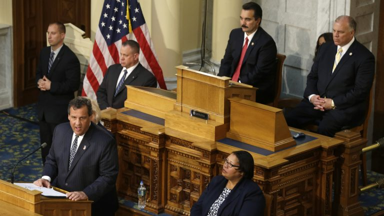As New Jersey Senate President Stephen M. Sweeney, right,  and Assembly Speaker Vinnie Prieto, second right, listen, Gov. Chris Christie addresses a joint session of New Jersey's Legislature after calling for a special session to work on overhauling New Jersey's bail system Thursday. (AP pPhoto/Mel Evans)