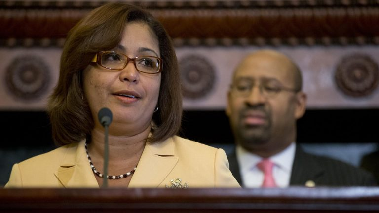 Philadelphia City Councilwoman Maria D. Quinones-Sanchez speaks as Philadelphia Mayor Michael Nutter looks on during a January signing ceremony for an ordinance creating the  municipal land bank. (AP file photo)