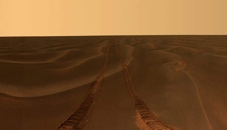 This image, taken by Mars rover Opportunity, shows rover tracks disappearing toward the horizon in a sea of sand between the craters Endurance and Victoria on the Meridiani Plains. (AP Photo/NASA/JPL-Caltech/Cornell University)
