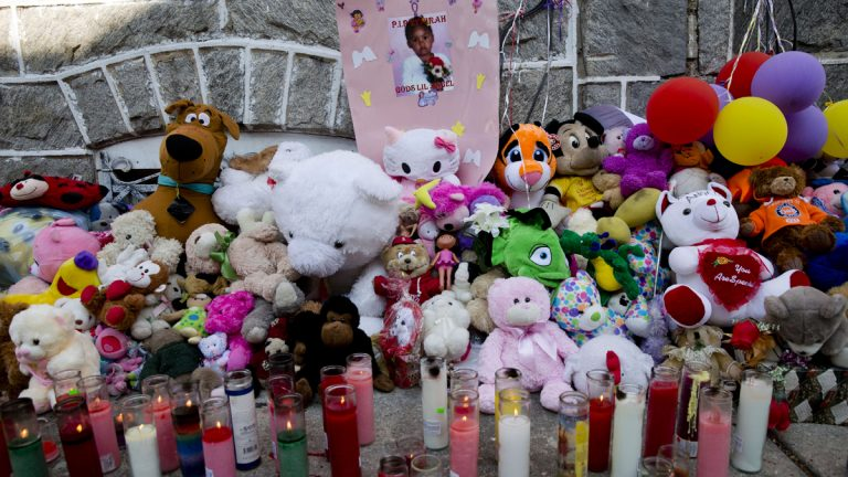 A makeshift memorial is dedicated to  3-year-old Tynirah Borum who was fatally shot in the chest by a stray bullet Aug. 1.(Matt Rourke/AP Photo)