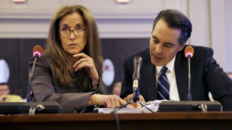 The New Jersey legislative panel investigating the George Washington  Bridge lane-closing scandal  is seeking phone records of Regina Egea, shown listening to a question along with attorney Michael Martinez in July. (AP file photo)