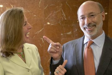 Katie McGinty and Tom Wolf share a laugh on the campaign trail. Gov.-elect Wolf has appointed McGinty his chief of staff. (AP file photo)