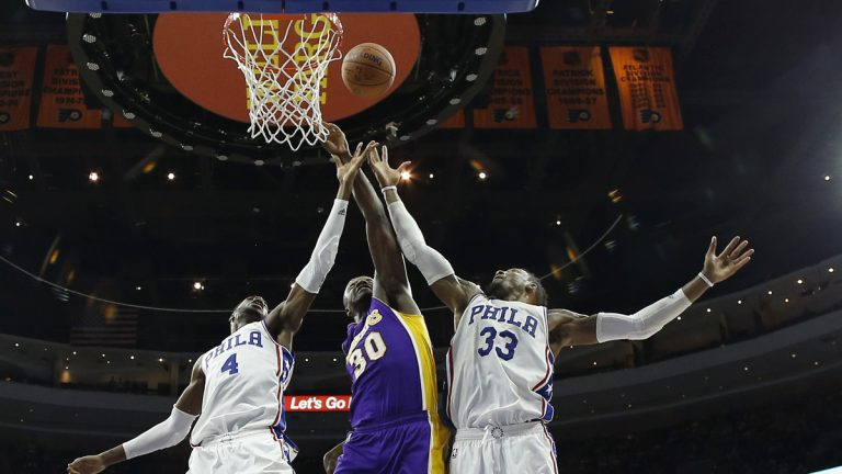 Philadelphia 76ers' Nerlens Noel (4) and Robert Covington (33) leap for a rebound against Los Angeles Lakers' Julius Randle (30) during the second half of an NBA basketball game