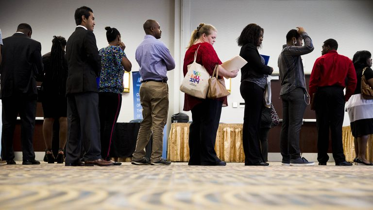 People wait to meet recruiters at a Philadelphia job fair in June 2014. Job preparedness and employment was one of the five areas Governor Wolf's administration identified that could benefit from Pay for Success performance contracts. (AP Photo/Matt Rourke)