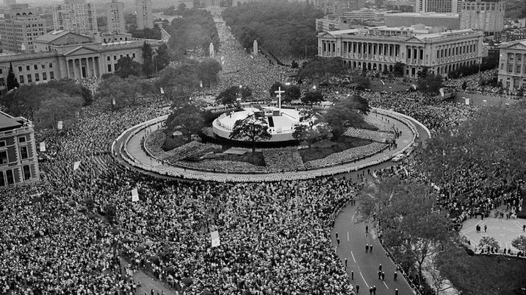 In this Oct. 3, 1979 file photo Pope John Paul II performs an outdoor mass for a huge audience at Logan Circle in Philadelphia.  (AP file photo)