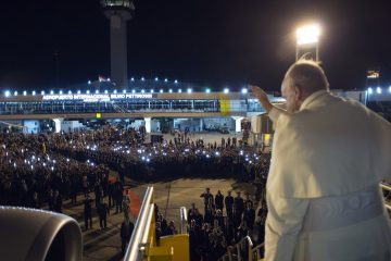In this photo taken on Sunday, July 12, 2015, Pope Francis waves as he boards the plane back to Rome, in Asuncion, Paraguay. Pope Francis departed after a week long trip to Ecuador, Bolivia and Paraguay. (L'Osservatore Romano/Pool Photo via AP)