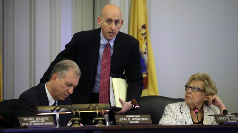 N.J. Assemblyman John S. Wisniewki, left, Sen. Loretta Weinberg, right,  listen as Reid Schar, special counsel to the Assembly committee, answers a question in Trenton, N.J., Tuesday, June 3, 2014.  (AP Photo/Mel Evans)
