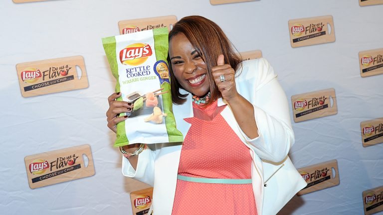 Meneko Spigner McBeth of Deptford, New Jersey, celebrates as her Lay's Kettle Cooked Wasabi Ginger potato chip flavor submission was named the $1 million grand-prize winner of a contest sponsored by the snack maker. (Diane Bondareff/Invision for Frito-Lay/AP Images)