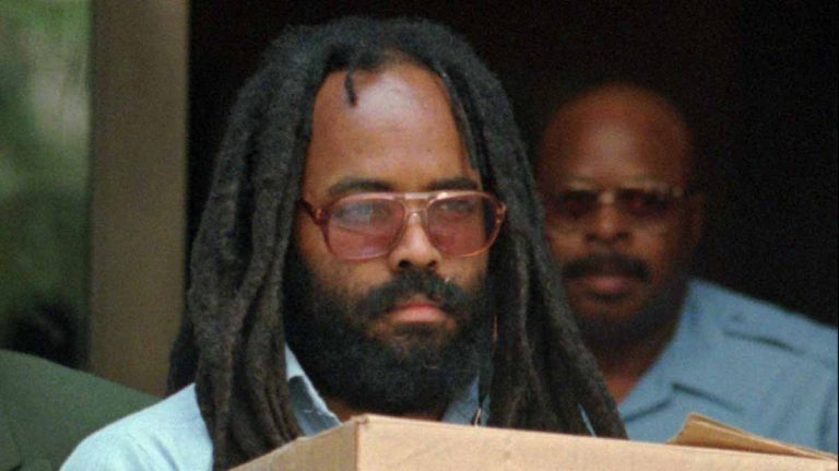 Mumia Abu-Jamal leaving a court hearing in 1995. (AP Photo/Chris Gardner, File)