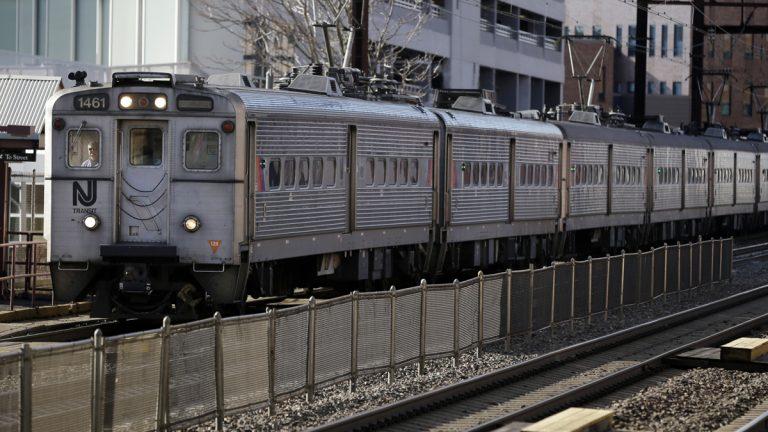 An NJ Transit train approaches the New Brunswick train station. (AP Photo/Mel Evans)