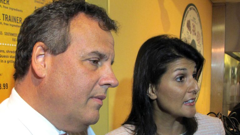 New Jersey Gov. Chris Christie and South Carolina Gov. Nikki Haley answer questions in Charleston. Christie's frequent travels and all the talk of a presidential bid have affected his job performance, N.J. voters said in poll released Wednesday. (Bruce Smith/AP)