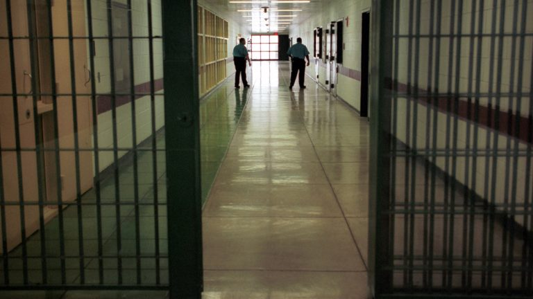 Officers at the Cumberland County Prison in Carlisle, Pennsylvania, walk the halls. (AP file photo)