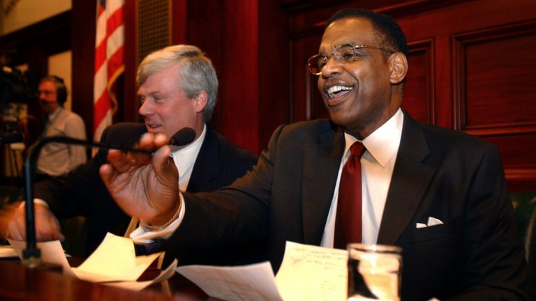 Francis Barnes, right, prepares to answer questions moments before his confirmation hearing as Pennsylvania's education secretary in 2004. Barnes has been appointed receiver of the troubled Chester-Upland School District. (AP file photo)