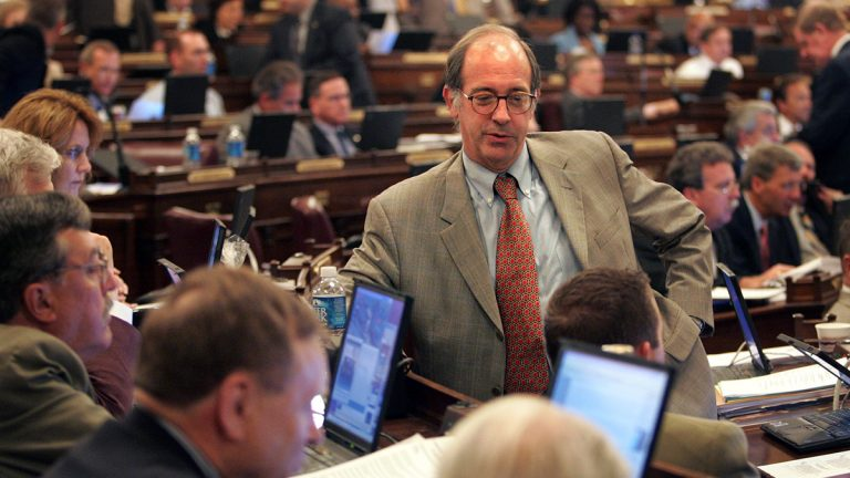 Rep. Chris Ross, R-Chester, talks to other lawmakers on the floor of the Pennsylvania House of Representatives at the Capitol in Harrisburg in 2006. He is retiring after 19 years. (AP file photo)