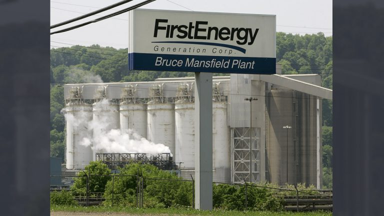 A portion of FirstEnergy Corporation's Bruce Mansfield electricity generating plant is seen behind the sign at the main gate in Shippingport