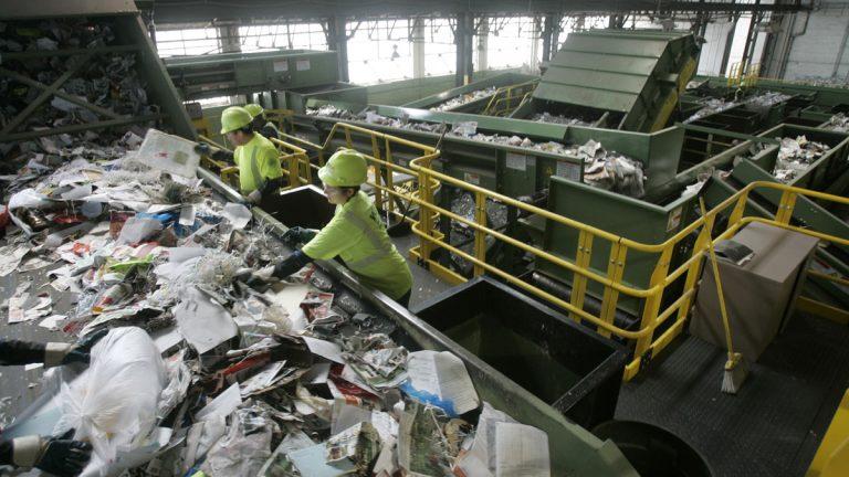 Workers sort through paper
