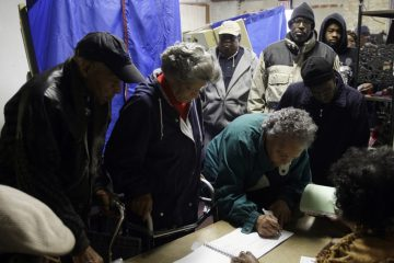 Voters sign polling book in Philadelphia. (AP file photo)
