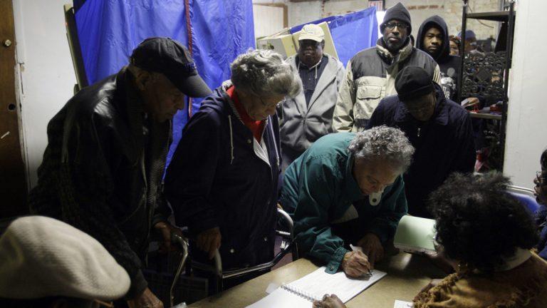 Voters sign polling book in Philadelphia. (AP file photo)