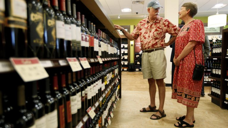 Customers check out the selection at a state wine and liquor store in New Hope. Pa. State lawmakers are once again considering changes to the system that would expand wine and beer sales to more private stores and give greater flexibility to the state stores.(AP file photo/Matt Rourke)