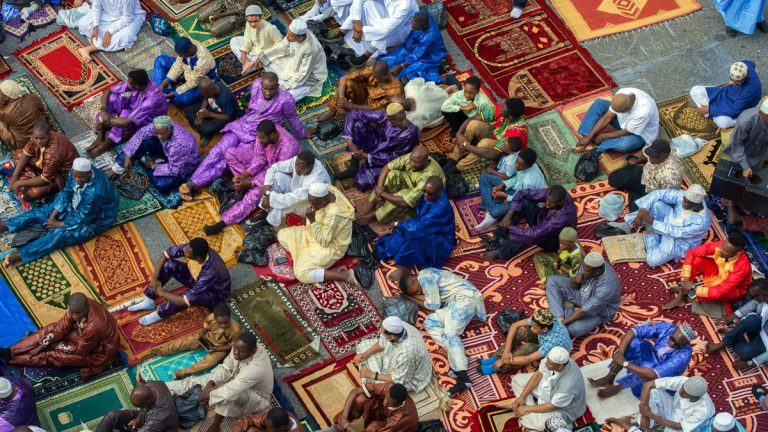 Worshipers in New York's East Harlem neighborhood take part in the traditional annual prayer commemorating Eid al-Fitr