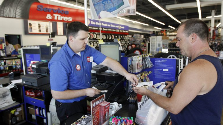 Pep Boys Auto retail sales manager Matt Myers hands costumer Michael Simmons of Philadelphia his change at a Pep Boys Auto retail and service location in Philadelphia.  (AP file photo)