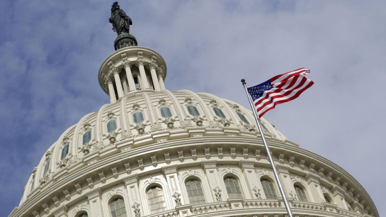 Half of those surveyed in a Monmouth University poll   believe the federal government is hurting rather than helping their lives, (AP file photo)