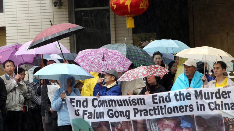 Demonstrators with the organization, End the Persecution of Falun Gong Practitioners in China, protest outside the Chinese consulate in 2012 in Los Angeles. (AP photo)