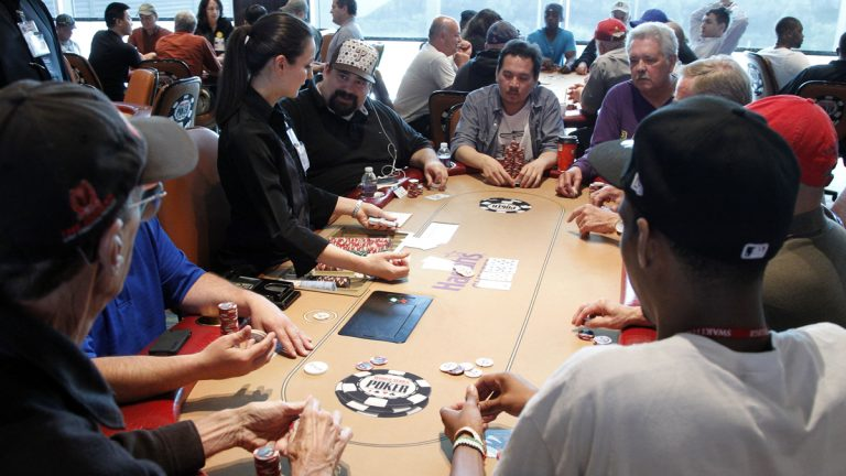 Gamblers play poker at Harrah's in Chester City