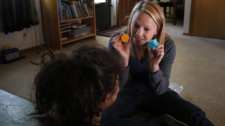 Speech pathologist Kelly Kuehl conducts a speech therapy session in Denver in 2012. (AP Photo/Jae C. Hong)
