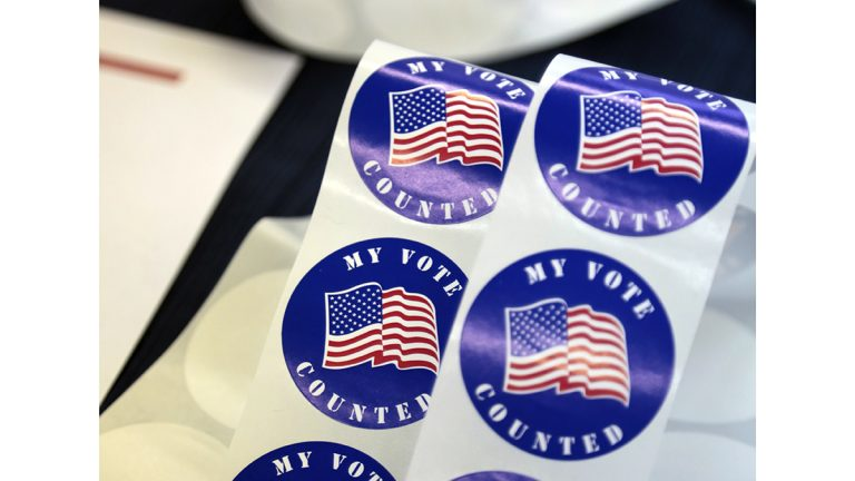 Stickers for voters are seen on a table at a polling station Tuesday