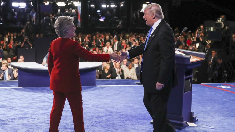 Democratic presidential nominee Hillary Clinton shakes hands with Republican presidential nominee Donald Trump after the presidential debate at Hofstra University in Hempstead