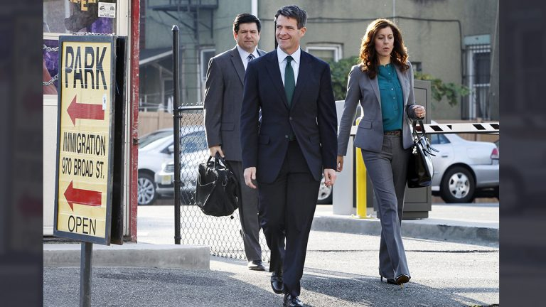 Bill Baroni (center) walks with his attorneys Jennifer Mara and Michael Baldassare toward the federal courthouse in Newark