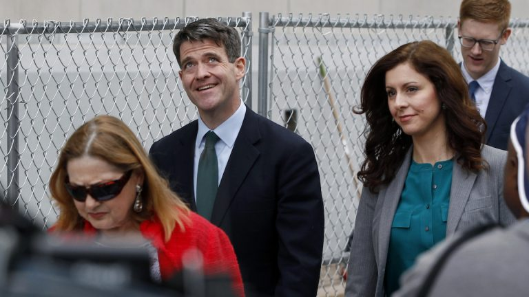 Bill Baroni (center) looks up while walking with his attorney Jennifer Mara (second right) as they leave Martin Luther King Jr. Federal Courthouse after court proceedings
