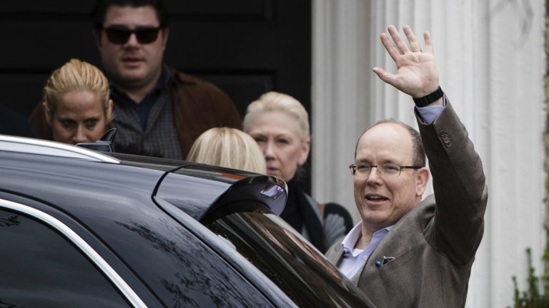 Prince Albert II of Monaco waves after touring a house he recently purchased in Philadelphia, Tuesday, Oct. 25, 2016. It's the home where his mother, Oscar-winning actress Grace Kelly, grew up and accepted a marriage proposal from Prince Rainier III of Monaco. (AP Photo/Matt Rourke)