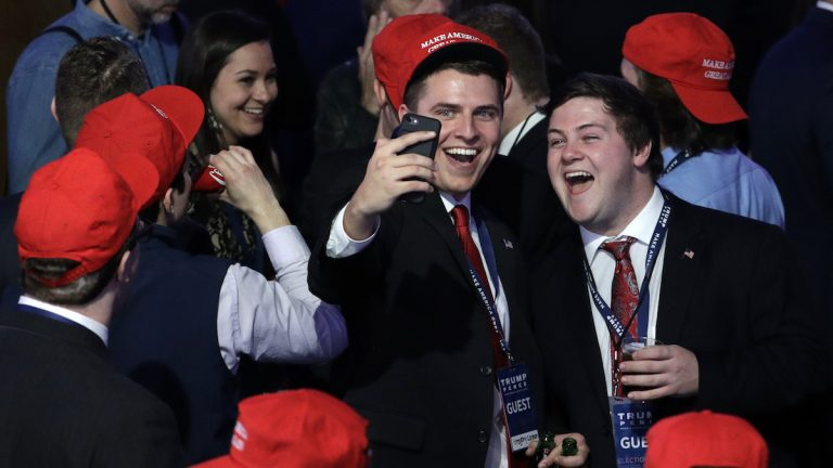Supporters of Republican presidential candidate Donald Trump take a selfie as they watch the election results during Trump's election night rally