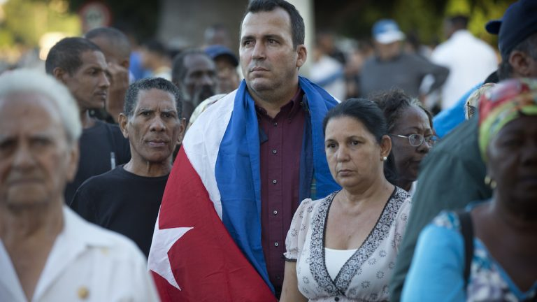 Mourners wait to enter Revolution Square at the start of weeklong services honoring Fidel Castro