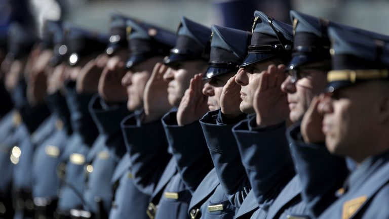 New Jersey State Police officers salute prior to an NFL football game between the New York Jets and the Buffalo Bills Sunday in East Rutherford