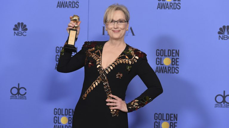 Meryl Streep poses in the press room with the Cecil B. DeMille award at the 74th annual Golden Globe Awards at the Beverly Hilton Hotel on Sunday
