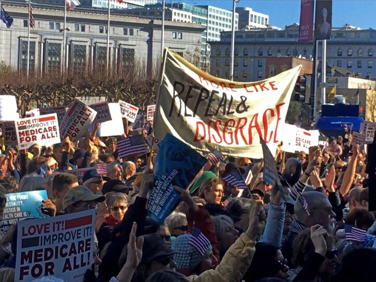 People rally against the dismantling of the Affordable Care Act during a gathering in San Francisco