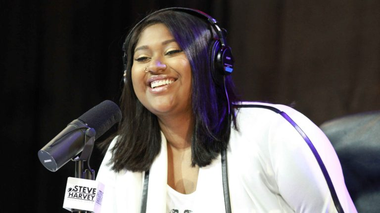 Jazmine Sullivan performs during the Steve Harvey Morning Show at the Georgia World Congress Center in August. (Photo by Robb D. Cohen/Invision/AP)