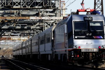 A New Jersey Transit train travels across a portal bridge in Kearny, New Jersey. NJ Transit will nt meet the federal deadline for installation of the new safety measure