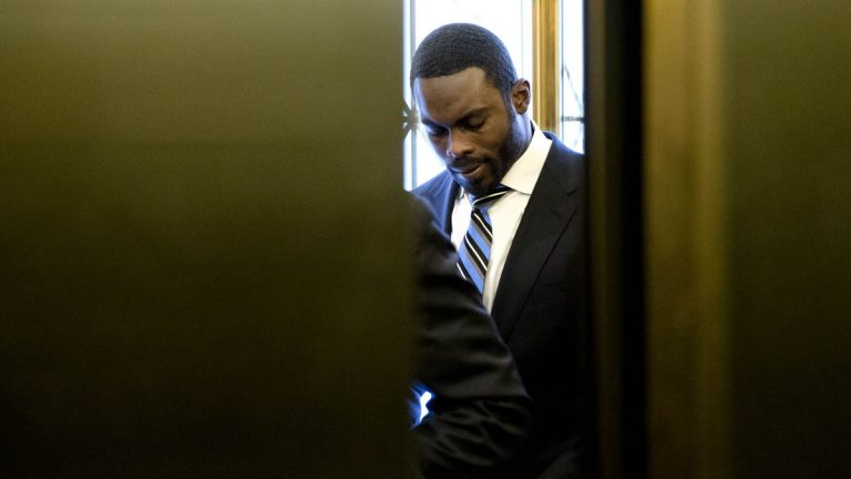 Elevator doors close after Pittsburgh Steelers quarterback Michael Vick arrives at the Pennsylvania Capitol Tuesday in Harrisburg. Vick is lobbying state legislators on a bill that would help protect pets left in hot cars. Vick was a star quarterback for the NFL's Atlanta Falcons when he pleaded guilty in 2007 to being part of a dogfighting ring and ended up serving 21 months in prison. (AP Photo/Matt Rourke)