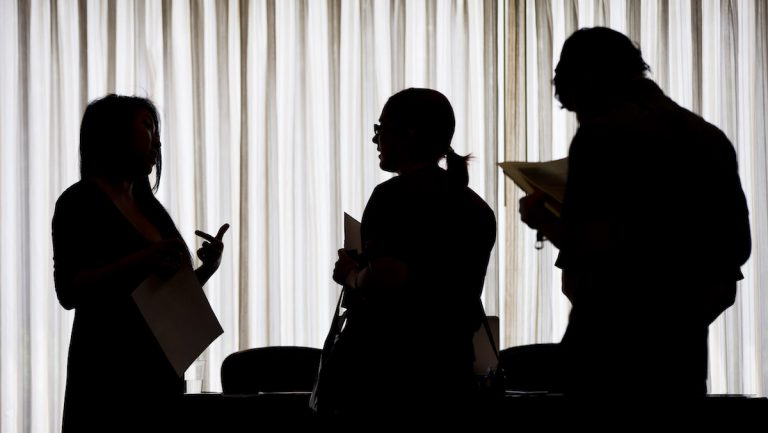 Applicants complete forms at a job fair in Newark N.J. in February 2013. (AP Photo/Mark Lennihan)